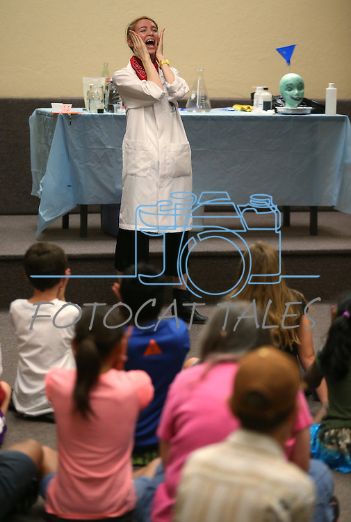 Radioactive Rachel teaches a Mad Science program at the Carson City Library, in Carson City, Nev., on Tuesday, July 15, 2014.<br /> Photo by Cathleen Allison