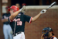Jeremy Baltz #18 of the St. John's Red Storm follows through on his swing against the Virginia Cavaliers in the championship game of the Charlottesville Regional at Davenport Field on June 7, 2010, in Charlottesville, Virginia.  The Cavaliers defeated the Red Storm 5-3.  Photo by Brian Westerholt / Four Seam Images