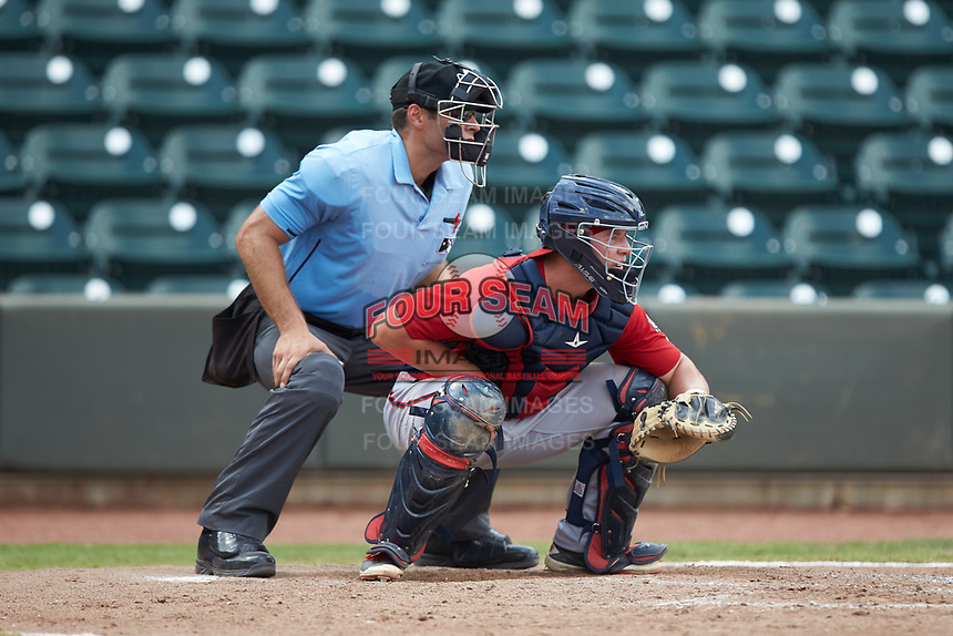 Potomac Nationals catcher Jakson Reetz (12) sets a target as home plate umpire Dane Poncsak looks on during the game against the Winston-Salem Rayados at BB&T Ballpark on August 12, 2018 in Winston-Salem, North Carolina. The Rayados defeated the Nationals 6-3. (Brian Westerholt/Four Seam Images)