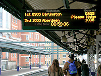 Illuminated arrivals and departures sign at Reading, Berkshire train station.