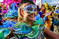 A Colombian woman, wearing a colorful costume and make-up, dances during the Carnival in Barranquilla, Colombia, 27 February 2006. The Carnival of Barranquilla is a unique festivity which takes place every year during February or March on the Caribbean coast of Colombia. A colourful mixture of the ancient African tribal dances and the Spanish music influence - cumbia, porro, mapale, puya, congo among others - hit for five days nearly all central streets of Barranquilla. Those traditions kept for centuries by Black African slaves have had the great impact on Colombian culture and Colombian society. In November 2003 the Carnival of Barranquilla was proclaimed as the Masterpiece of the Oral and Intangible Heritage of Humanity by UNESCO.