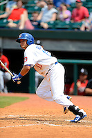 Chattanooga Lookouts shortstop Miguel Rojas #13 singles in the winning run during a game against the Birmingham Barons on April 17, 2013 at AT&T Field in Chattanooga, Tennessee.  Chattanooga defeated Birmingham 5-4.  (Mike Janes/Four Seam Images)