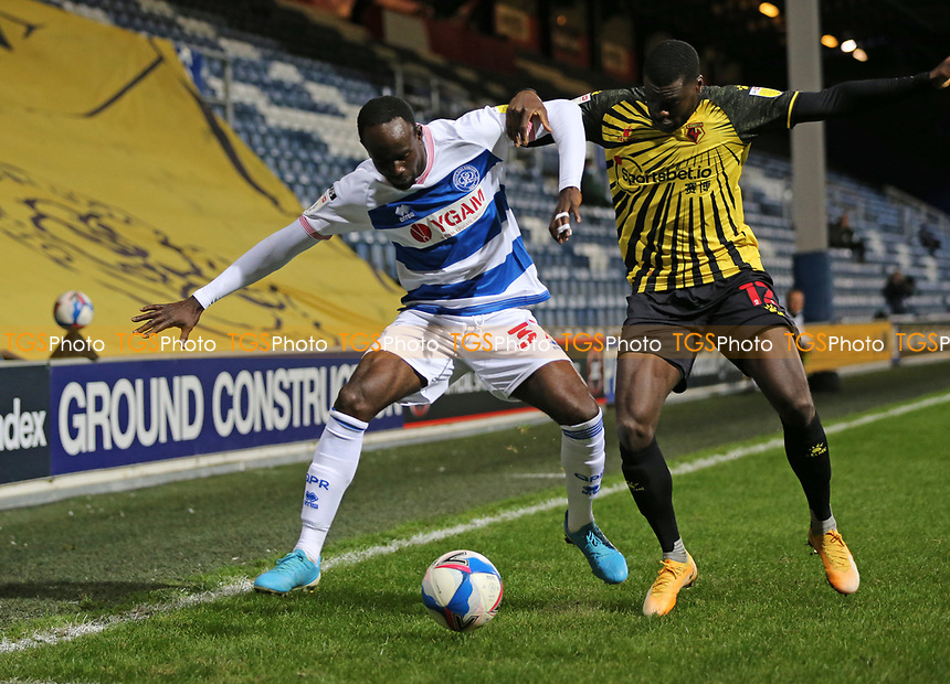 Albert Adomah of  Queens Park Rangers and Ken Sema of Watford both go for the ball during Queens Park Rangers vs Watford, Sky Bet EFL Championship Football at The Kiyan Prince Foundation Stadium on 21st November 2020