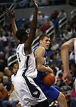 Nevada's Cole Huff blocks Air Force's Marek Olesinski during an NCAA basketball game in Reno, Nev., on Saturday, Feb. 1, 2014. Nevada won 69-56 in overtime. (AP Photo/Cathleen Allison)