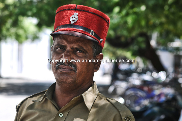 An Indian traffic police wearing a cap. These Caps are one of the French things still used in Pondicherry. Arindam Mukherjee