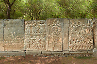 Pictures & images of the North Gate ancient Hittite stele stone slabs with stele of Hittite Gods, mythical beasts and lion as well as carvings of the Phoenician language  known as the Karatepe bilingual, which allowed academics to translate Hittite hieroglyphs. 8th century BC discovered in 1946. Karatepe Aslantas Open-Air Museum (Karatepe-Aslantaş Açık Hava Müzesi), Osmaniye Province, Turkey.