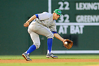Third baseman Hunter Dozier (13) of the Lexington Legends fields a ground ball in a game against the Greenville Drive on Friday, August, 16, 2013, at Fluor Field at the West End in Greenville, South Carolina. Dozier was the No. 1 pick (eighth overall) by the Kansas City Royals in the first round of the 2013 First-Year Player Draft. He played collegiate ball for Stephen F. Austin University. Greenville won, 2-1. (Tom Priddy/Four Seam Images)