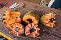 Cuba, Havana.  Cut Papaya for Sale.