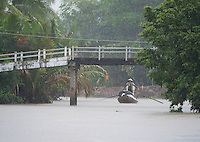 "Almost zero visibility during a heavy Monsoon rain storm near Can Tho, the hub of the Mekong Delta (Vietnamese: Đồng bằng Sông Cửu Long ""Nine Dragon river delta""), also known as the Western Region (Vietnamese: Miền Tây or the South-western region (Vietnamese: Tây Nam Bộ) is the region in southwestern Vietnam where the Mekong River approaches and empties into the sea through a network of distributaries. The Mekong delta region encompasses a large portion of southwestern Vietnam of 39,000 square kilometres (15,000 sq mi). The size of the area covered by water depends on the season.<br />