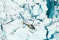 A helicopter's flying over seracs and crevasses on the Franz Josef Glacier - Westland National Park