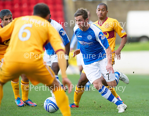 St Johnstone v Motherwell...03.11.12      SPL.Chris Millar closed down by Tom Hateley.Picture by Graeme Hart..Copyright Perthshire Picture Agency.Tel: 01738 623350  Mobile: 07990 594431