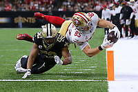 NEW ORLEANS, LOUISIANA - DECEMBER 08: George Kittle #85 of the San Francisco 49ers scores a touchdown as Craig Robertson #52 of the New Orleans Saints defends during the second half of a game at the Mercedes Benz Superdome on December 08, 2019 in New Orleans, Louisiana. (Photo by Jonathan Bachman/Getty Images)