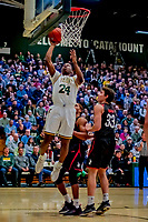 16 December 2018: University of Vermont Catamount Guard Ben Shungu, a Redshirt Sophomore from Burlington, VT, lays one up in first half action against the Northeastern University Huskies at Patrick Gymnasium in Burlington, Vermont. The Catamounts defeated the Huskies 75-70 in NCAA Division I America East play. Mandatory Credit: Ed Wolfstein Photo *** RAW (NEF) Image File Available ***