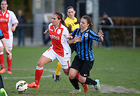 20150428 - VARSENARE , BELGIUM : Standard's Vanity Lewerissa pictured in action with Brugge's Jody Vangheluwe (right) during the soccer match between the women teams of Club Brugge Vrouwen and Standard de Liege Femina , on the 24th matchday of the BeNeleague competition Tuesday 28 th April 2015 in Varsenare . PHOTO DAVID CATRY