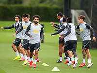 14th September 2021: The  AXATraining Centre, Kirkby, Knowsley, Merseyside, England: Liverpool FC training ahead of Champions League game versus AC Milan on 15th September: Mohammed Salah of Liverpool  warms up with his team mates