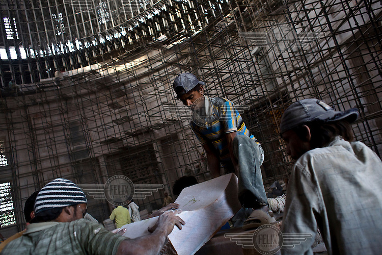 Migrant labourers working on Asia's biggest dome, the Kanshi Ram Smarak (monument), built by Uttar Pradesh Chief Minister, Mayawati who is channeling huge state funds into making statues and monuments to herself and her mentor, Kanshi Ram all across Lucknow.