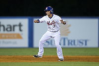 Kingsport Mets pinch-runner Jose Figuera (7) takes his lead off of second base against the Elizabethton Twins at Hunter Wright Stadium on July 9, 2015 in Kingsport, Tennessee.  The Twins defeated the Mets 9-7 in 11 innings. (Brian Westerholt/Four Seam Images)