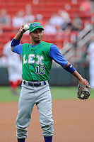 Second baseman Ramon Torres (12) of the Lexington Legends before a game against the Greenville Drive on Friday, August 18, 2013, at Fluor Field at the West End in Greenville, South Carolina. Lexington won, 5-0. (Tom Priddy/Four Seam Images)