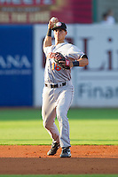 Shortstop Rick Hague #18 of the Hagerstown Suns makes a throw to first base against the Greensboro Grasshoppers at NewBridge Bank Park July 30, 2010, in Greensboro, North Carolina.  Photo by Brian Westerholt / Four Seam Images