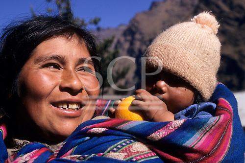 Sandia, San Juan del Oro, Peru. Woman with baby carried in a manta on her back.