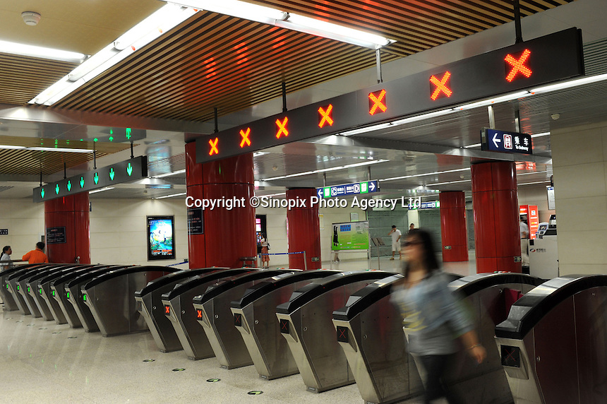 Electronic turnstiles in the Beijing Subway, China. Beijing Subway is a rapid transit rail network that serves the urban and suburban districts of Beijing municipality. It is the oldest and busiest subway in mainland China, and the second longest after the Shanghai Metro..30 Aug 2010