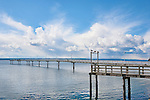 The long fishing pier at Des Moines marina extends far over Puget Sound.  It's popular with walkers, fishermen, and tourists alike. Please contact the photographer regarding licensing this image.