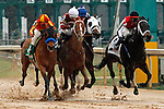 #5 Hoppertunity (left) #3 Tapiture (middle) and #2 Ride On Curlin (right) fighting it out close to the finish line in the Rebel Stakes (Grade II) at Oaklawn Park in Hot Springs, Arkansas-USA on March 15, 2014. (Credit Image: © Justin Manning/Eclipse/ZUMAPRESS.com)