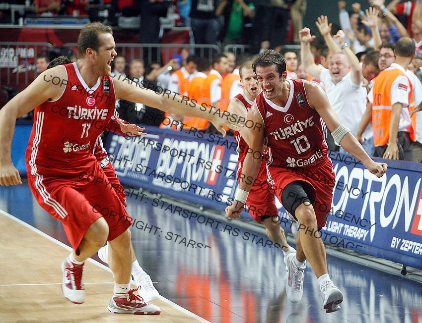 Kerem TUNCERI (Turkey) and Oguz SAVAS (Turkey) celebrates win over Serbia , semi-final World championship basketball match in Istanbul, Serbia-Turkey, Turkey on Saturday, Sep. 11, 2010. (Novak Djurovic/Starsportphoto.com) .