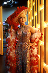 Actress dressed as film legend Mae West on a movie set in Hollywood, CA