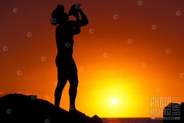 Conch blower at sunset at Kihei, Maui.