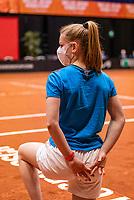 Den Bosch, The Netherlands, April 17, 2021,    Maaspoort, Billie Jean King Cup  Netherlands -  China , Ballgirl with facemask<br /> Photo: Tennisimages/Henk Koster