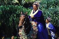 A Pa'u rider in the annual Aloha Festivals Parade rides a floral-bedecked horse. Her attire is one continuous piece of fabric, wrapped in a traditional way.