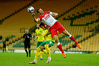 3rd November 2020; Carrow Road, Norwich, Norfolk, England, English Football League Championship Football, Norwich versus Millwall; Jake Cooper of Millwall heads the ball clear above Max Aaron of Norwich City