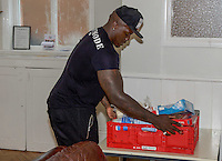 Adebayo Akinfenwa of Wycombe Wanderers - How the strongest man in football is spreading the Christmas cheer. <br /> <br /> Interview and feature will be shown on Sky Sports News HQ and across Sky Sports digital platforms Christmas Day.<br /> <br /> Bayo Akinfenwa helps out at a Food Bank in Lewisham, England on 23 December 2016.  <br /> <br /> Photo by Alan  Stanford / PRiME Media Images.