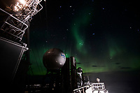 The Aurora Borealis viewed from the deck of the ice-breaking vessel 'Fedor Ushakov' as it sails on the Barents Sea.