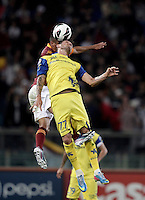 Calcio, Serie A: Roma vs Chievo Verona, Stadio Olimpico, Roma, 7 maggio  2013..AS Roma defender Marquinhos, of Brazil, partially hidden and ChievoVerona forward Cyril Thereau, of France, jump for the ball during the Italian serie A football match between Roma and ChievoVerona at Rome's Olympic stadium, 7 maggio  2013..UPDATE IMAGES PRESS/Isabella Bonotto