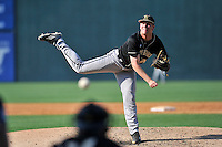 Starting pitcher Matthew Milburn (24) of the Wofford Terriers delivers a pitch in a SoCon Tournament game against Western Carolina on Wednesday, May 25, 2016, at Fluor Field at the West End in Greenville, South Carolina. Western won, 10-9. (Tom Priddy/Four Seam Images)