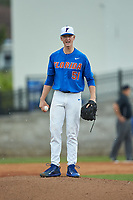 Florida Gators starting pitcher Brady Singer (51) yells in the direction of the ESPN time-out coordinator, wanting him to get the inning started against the Wake Forest Demon Deacons in Game Three of the Gainesville Super Regional of the 2017 College World Series at Alfred McKethan Stadium at Perry Field on June 12, 2017 in Gainesville, Florida.  (Brian Westerholt/Four Seam Images)