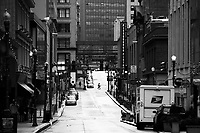 An empty Forbes Avenue in downtown during rush hour on Monday March 23, 2020 in Pittsburgh, Pennsylvania. (Photo by Jared Wickerham/Pittsburgh City Paper)