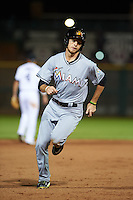 Mesa Solar Sox shortstop J.T. Riddle (7) running the bases during an Arizona Fall League game against the Scottsdale Scorpions on October 20, 2015 at Scottsdale Stadium in Scottsdale, Arizona.  Mesa defeated Scottsdale 5-4.  (Mike Janes/Four Seam Images)