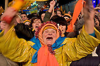 Kiev, Ukraine, 26-27/12/2004..The third and final round of Ukraine's disputed Presidential election. Supporters of Viktor Yushchenko clebrate in Maiden Square as early returns indicate he will win the Presidency by a comfortable margin.