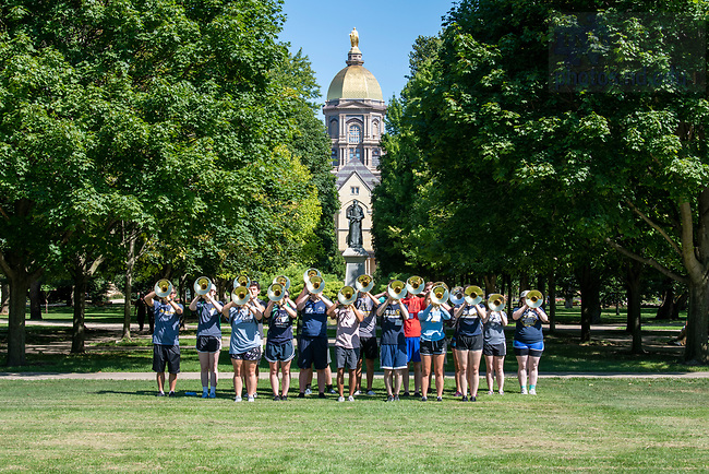 August 23, 2019; Notre Dame March Band members pose for a photo on South Quad during the kick off of Welcome Weekend 2019. (Photo by Barbara Johnston/University of Notre Dame)