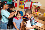 Education Preschool 4 year olds pretend play group of children playing game girl getting haircut ordering food from chef