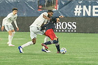 FOXBOROUGH, MA - NOVEMBER 1: Gustavo Bou #7 of New England Revolution defends against a tackle by Donovan Pines #23 of DC United during a game between D.C. United and New England Revolution at Gillette Stadium on November 1, 2020 in Foxborough, Massachusetts.