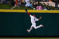 Thomas Pham (4) of the Springfield Cardinals attempts to make a catch on a ball hit to the wall during a game against the Tulsa Drillers on April 29, 2011 at Hammons Field in Springfield, Missouri.  Photo By David Welker/Four Seam Images.