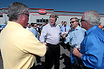 From left, Ron Sheehan, Rep. Mark Amodei, R-Nev., state Sen. Greg Brower, R-Reno, and Bob Ryan talk before a Republican Vice-Presidential candidate Rep. Paul Ryan, R-Wis., campaign stop at the Peterbilt Truck & Parts Equipment company in Sparks, Nev., on Friday, Sept. 7, 2012. (AP Photo/Cathleen Allison)