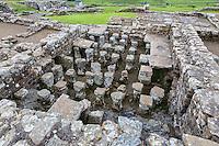 Northumberland,  England, UK.  Stones Supporting Heated Floor, Commander's House, Housesteads Roman Fort (Vercovicium).