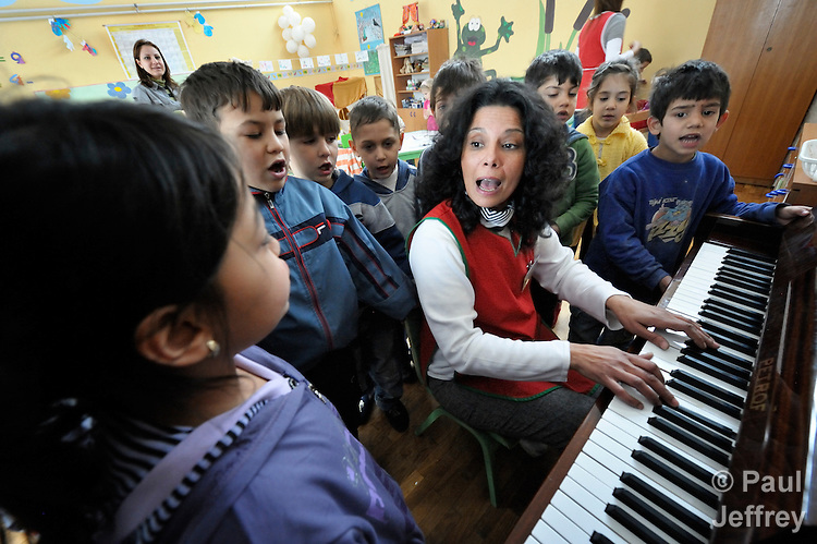 Sladjana Nedeljkovic, a Roma teacher at the Nasa Radost preschool in Smederevo, Serbia, leads children in singing. The children are all Roma, and most are from families who came to the area as refugees from Kosovo. The school's work is supported by Church World Service.