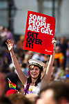 """© Joel Goodman - 07973 332324 - all rights reserved . 03/07/2010 . London , UK . A woman carrying a Stonewall placard reading """" Some People are Gay Get over it """" in Trafalgar Square . Annual London Pride march and demonstration through the centre of London . Photo credit : Joel Goodman"""