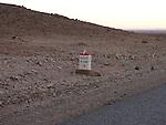 Roadsign on the edge of the Sahara Desert near Mhamid in Morocco.